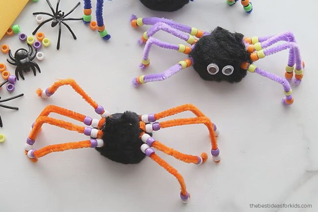 Glue spider legs on spider pom pom