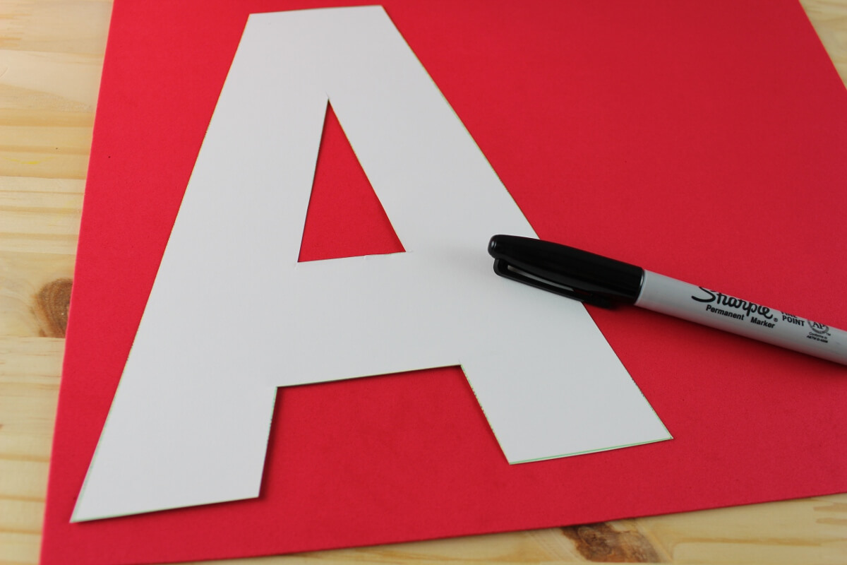 cut out the template letter a and trace onto the red craft foam now cut the letter out of the craft foam