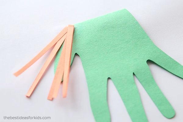 Glue down paper strips for hair