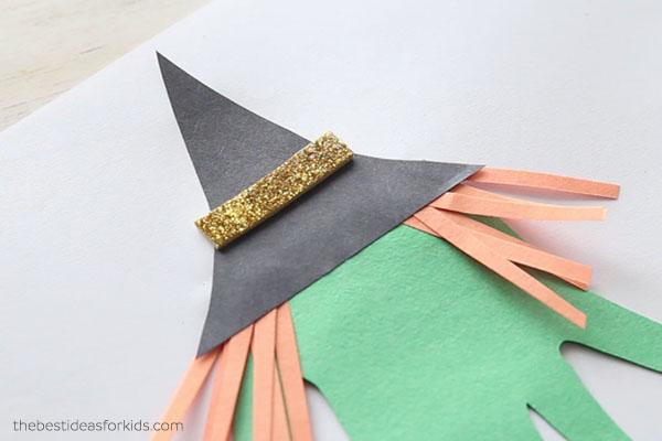 Glue on Hat Brim to Witch Handprint