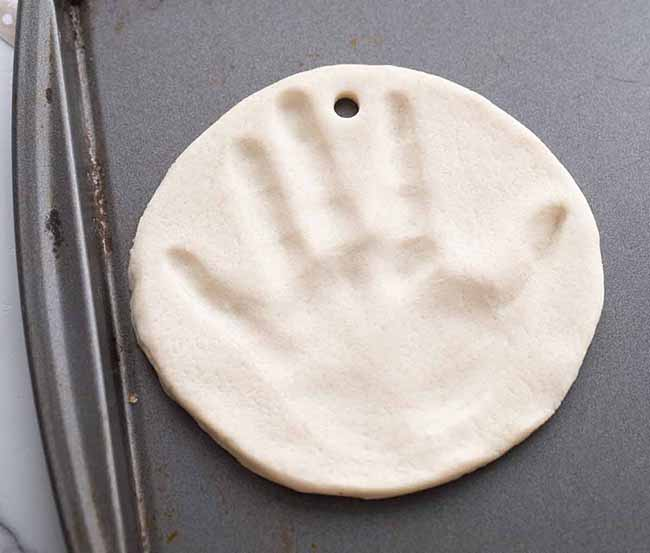 Place Handprint on Baking Tray