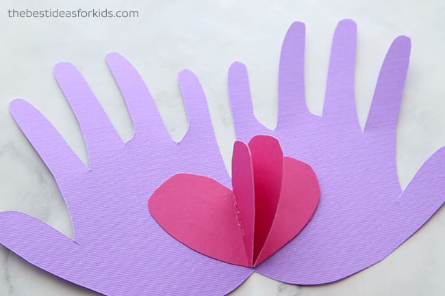 Glue Hearts to Handprint Valentine