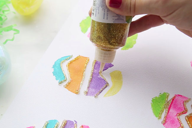 Add Glitter Glue to Potato Stamped Easter Eggs