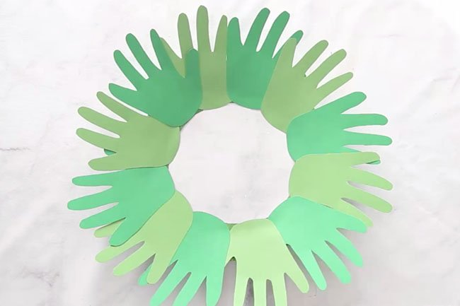 Glue Handprints to Paper Plate