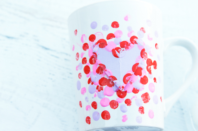 Add red paint to fingerprint mug