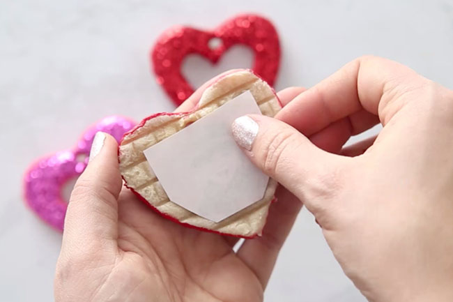 Glue photo to back of heart ornament