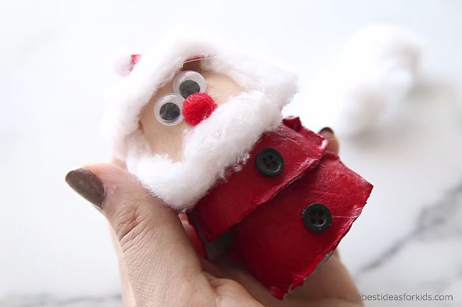 Glue Buttons on Egg Carton Santa