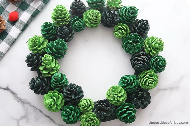 Glue Pine cones to DIY Pine Cone Wreath