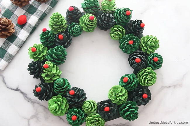Glue Pom Poms to Pine cone Wreath