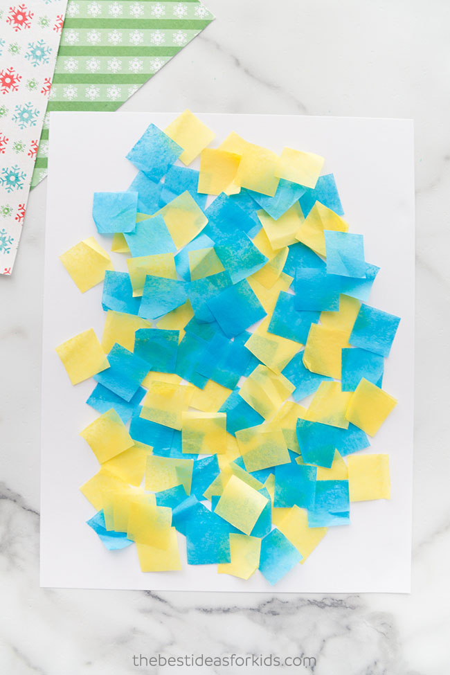 Put down tissue paper for Christmas art