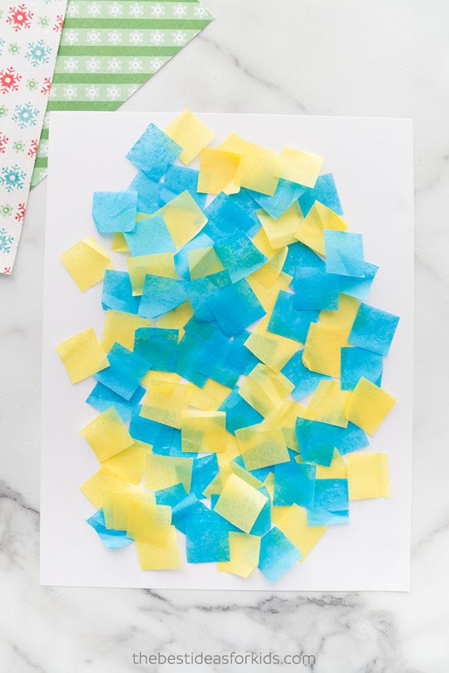 Put down tissue paper for Christmas art