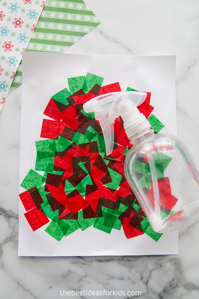 Soak tissue paper with water for Christmas art