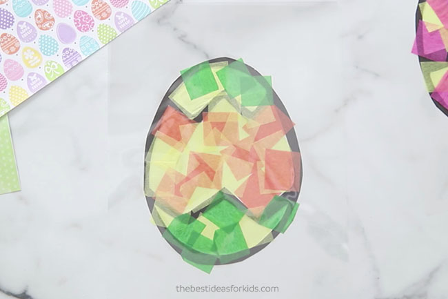 Add Laminating paper on top of Easter Suncatcher
