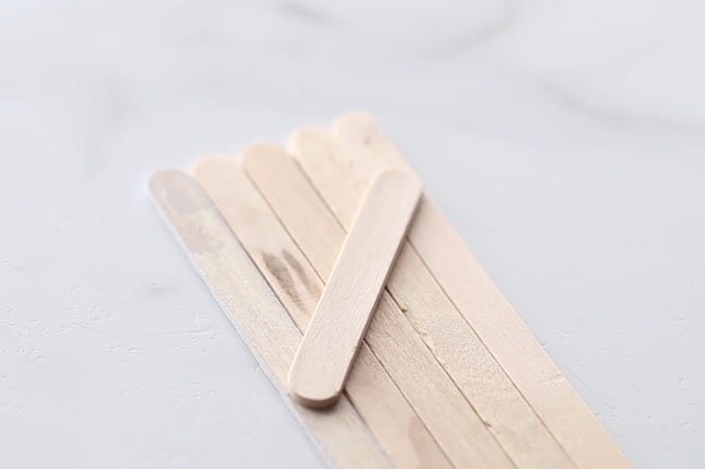 Glue Popsicle Stick to Back