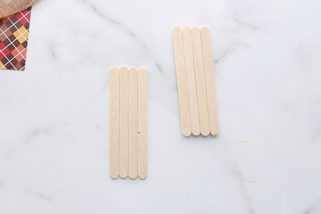 Get 4 popsicle sticks to make the scarecrow
