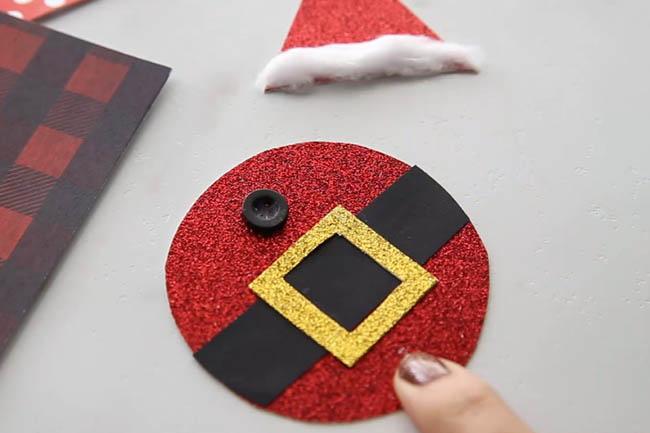 Glue on Button to Santa Body